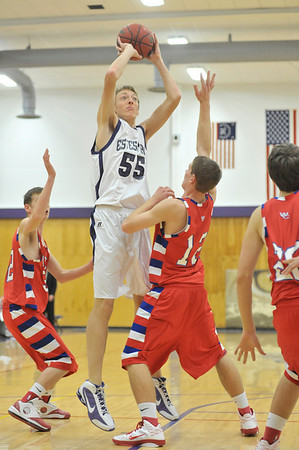 Walt Hester | Trail-Gazette<br /> Bobcats' senior Ben VanderWerf turns and scores his first points of the season against Weld Central on Tuesday. VanderWerf has see limited court time, but made the most of it on Tuesday.