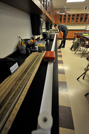 Walt Hester | Trail-Gazette<br /> Austin Pine, 16, works on a geological timeline in his science class on Werdnesday. As the lenth of his paper represents the entire 4.54 billion-year history of the earth, humans' time on earth amounts to a tiny segment.