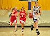 Walt Hester | Trail-Gazette<br /> Ali Scheil drives after an intercepted pass against the Eaton Reds on Friday. Scheil, a freshman, has been thrust into varsity play by the numerous injuries on her team.