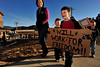 Walt Hester | Trail-Gazette<br /> Hayden, 4, and Ryan Owen, 7, carry their sign during the annual Martin Luthar King Peace March at the Estes Park Elementary School on Friday. Satruday, January 15, is the slain civil rights leader's 92nd birthday.