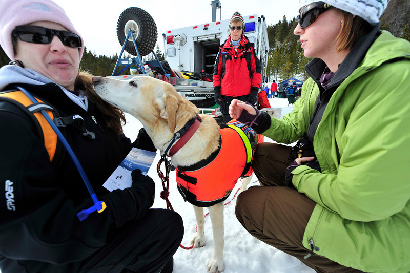 Walt Hester | Trail-Gazette<br /> Jenny Habecker of Reading, Pa., is not interested in kisses from search and rescue dog, Lakota, at the annual Winter Trails day in Rocky Mountain National Park on Saturday. Larimer Search and Rescue was on hand to demonstrate what dogs like Lakota can do.