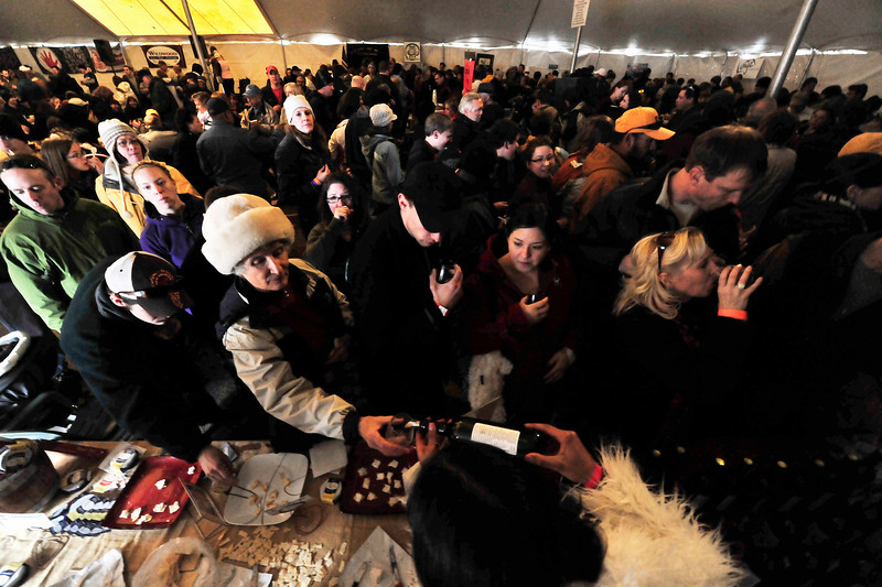 Walt Hester | Trail-Gazette<br /> Visitors jam the tasting tent at the Winter Festival in Bond Park on Saturday. Festival-goers had the chance to sample wine and beer, as well as local green and red chili on Saturday and award-winning competative varieties on Sunday.