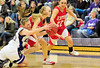 Walt Hester | Trail-Gazette<br /> Julia Lawrence demonstrates the aggressive defense that kept the Ladycats close to the third-ranked Reds throughout the game. Lawrence scored 10 points, as well.