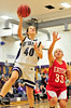 Walt Hester | Trail-Gazette<br /> Chelsea Weitzel lays up two of her team-leading 12 points against the Eaton Reds on Friday. While the Ladycats kept the game close, losing the the Reds by eight.