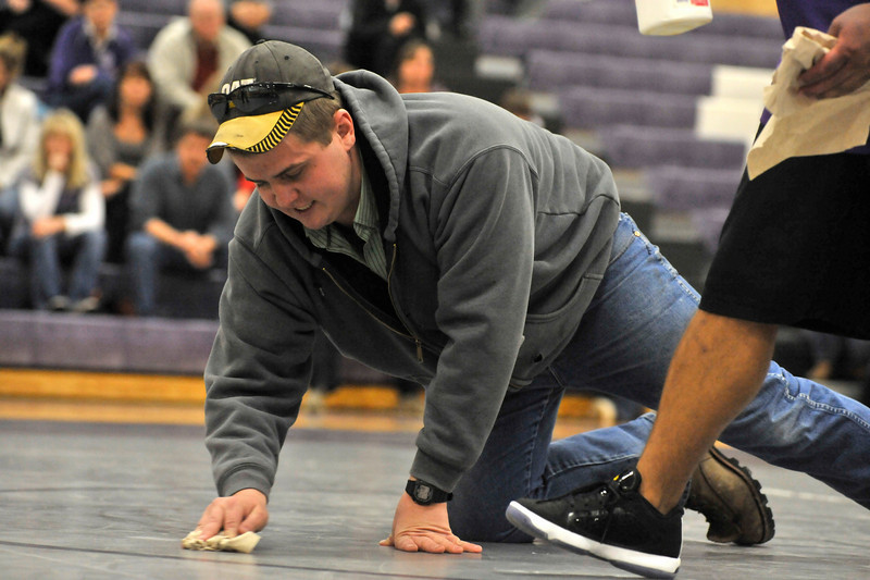 Walt Hester | Trail-Gazette<br /> Sam Kuster cleans blood off the mat at the Bobcats meet on Thursday.