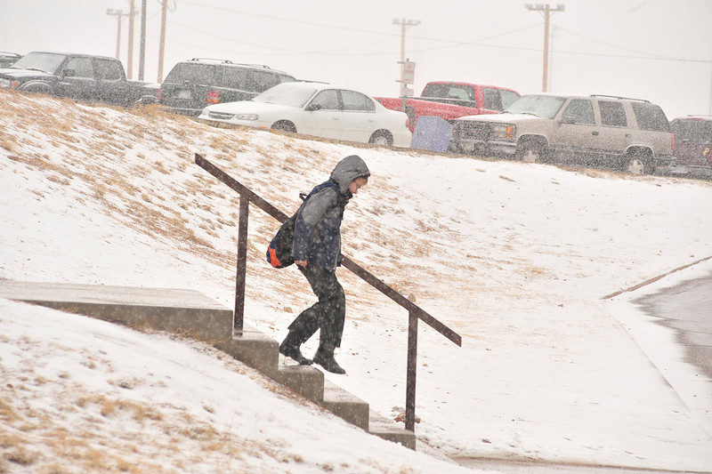 Walt Hester | Trail-Gazette<br /> Michael Ryan, 12 scurries throgh Wednesday's snow from the middle school to the high school for classes. The snow caused cancellation of some after-school activities as Front Range schools could not make the drive to Estes Park.