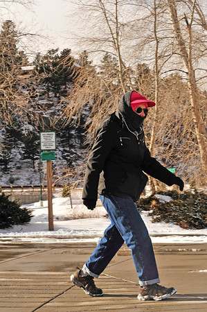 Walt Hester | Trail-Gazette<br /> Nancy Daly walks a brisk pace in brisk temperatures on Wednesday. Daly won't let sinus problems or cold weather stop her from her daily hike around Lake Estes.