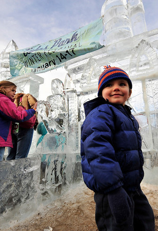 Walt Hester | Trail-Gazette<br /> Finley Helmugh, 2, seems to enjoy the Estes Park Winter Festival in Bond Park on Saturday. The winter weekend offered fun for all ages.