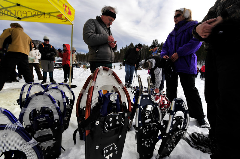 Walt Hester | Trail-Gazette<br /> Bill Scott of Outdoor World helps Christina Head of Arvada at the annual Winter Trails Day in Rocky Mountain National Park on Saturday. The event promotes winter fun in te park as well as offering the public a chance to try the newest winter gear.