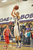 Walt Hester | Trail-Gazette<br /> Andrew Ciron shoots against Weld Central on Tuesday. Cirone led the Bobcats with 11 points in their 61-32 loss against the Eaton Reds on Friday.
