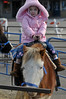 Walt Hester | Trail-Gazette<br /> Savannah Clayton, 4, of Highlands Ranch enjoys a lap around on her tiny mount downtown on Saturday. Pony rides, wgon rides, tastings, music and more were on offer this weekend at the festival.