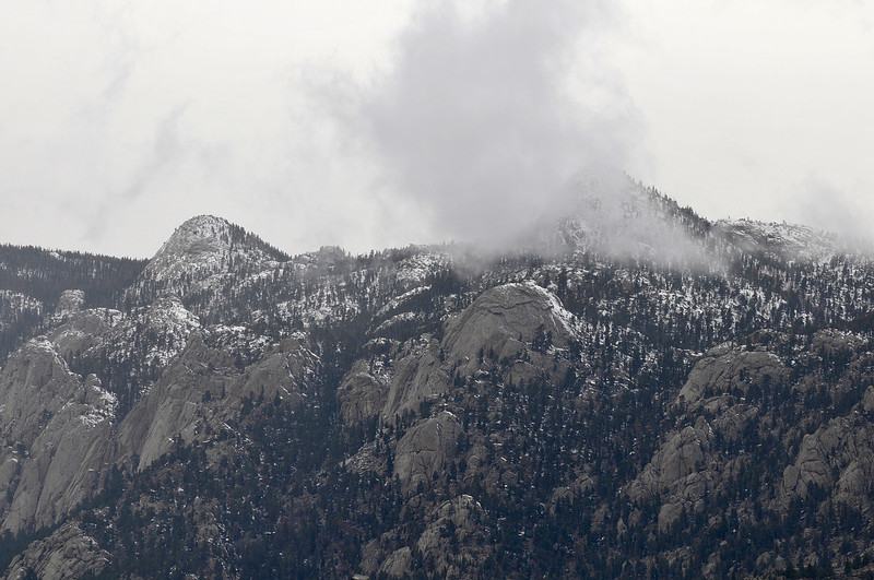 Walt Hester | Trail-Gazette<br /> Clouds and snow cling to the crags of Lumpy Ridge on Wednesday. Both snow and sunshine are expected over the next several days.