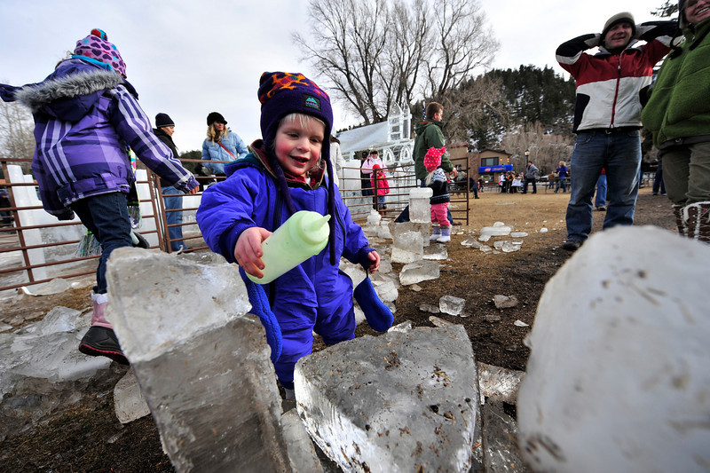 Walt Hester | Trail-Gazette<br /> Theo Niedringhaus-Schultz, 1, colors ice in Bond Park on Saturday. The festival provided fun for all ages.