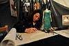 Walt Hester | Trail-Gazette<br /> Andria Amen sits in the big tent in Bond Park and sketches dress designs during the Winter Festival on Saturday. Andria Amen Custom Couture was one of a few non-chili venders at the event.