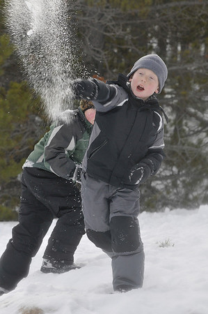 Walt Hester | Trail-Gazette<br /> Aiden Dahlbach, 7, of Thornton, launches a snowball attack at the snowshoe demo in Rocky Mountain National Park on Saturday. Dahlbach's Cub Scout pack, 606, took advantage of the nice day and free park admission, to stompand play outdoors in the snow.