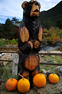 Walt Hester | Trail Gazette A large wooden bear seems to beg for more pumpkins along Moraine Avenue on Tuesday. As October progresses, autumnal events are emerging on the local calendar.