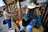 Walt Hester | Trail Gazette<br /> Ted Williams of Colorado Hats adjust decorations around his store's smiling scarecrow on Tuesday.