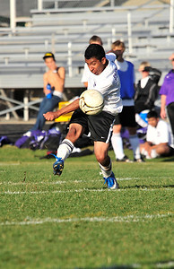"Walt Hester | Trail Gazette Jose ""Pepe"" Marquez fires a shot from outside the goalies box that would earn him his third of four goals against the visiting Bennett Tigers on Monday. The Bobcats' second half scoring was so prolific that officials began pulling Estes Park players in an effort to even the competition."