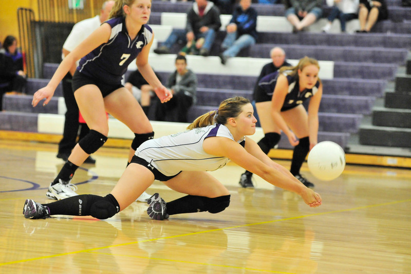 Walt Hester | Trail Gazette<br /> Estes Park's Audrey Ault digs under a hit by Platte Valley on Thursday. The Ladycats lost the match 3-0.