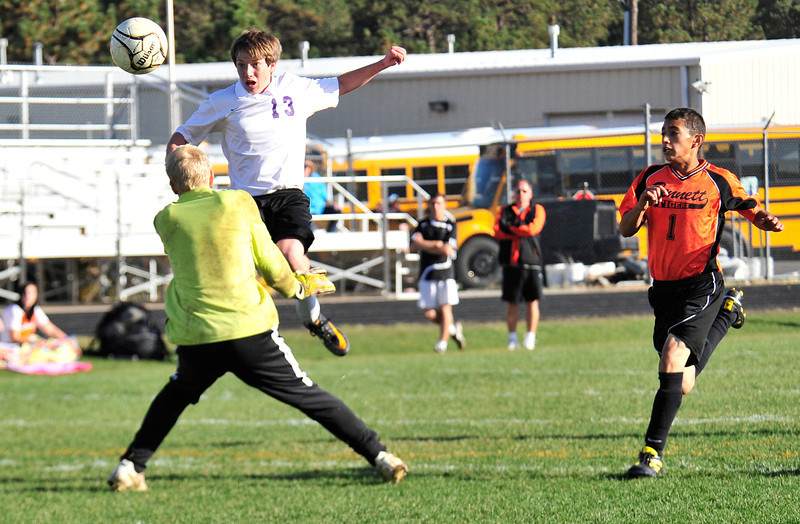 Walt Hester | Trail Gazette<br /> Zach Pierce pops the ball up over Brendon Grothe for the Bobcats' fifth goal of the first half. Pierce was one of three players to score multiple goals.