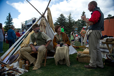Walt Hester | Trail Gazette Mike and Tere Morrison of Colorado Springs reaquaint themselves with David Hoth of Denver on Sunday. The Elk Fest mountain men treated the event like the old rendezvous in which the mountain people would catch up and trade with frinds they hadn't seen since the last rendevous.