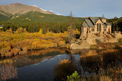 Walt Hester | Trail Gazette Autumn color surrounds the Chapel on the Rock at the St. Malo retreat along HWY 7 on Wednesday. St. Catherine of Siena's Chapel is one of the most photographed chapels in the state, with Mt. Meeker thrusting skyward behind it.