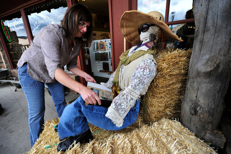 Walt Hester | Trail Gazette<br /> Cheryl Grigsby of Rocky Mountain Memories arranges a scrapbook for her scarecrow on Tuesday.