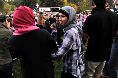 Walt Hester | Trail Gazette Fatmah Albrahim of Saudi Arabia enjoys the circle dance at the end of the Saturday Native American dance demo. The dance was described as the dance of friendship.