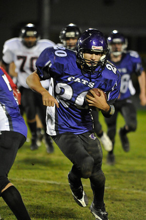 Walt Hester   Trail Gazette<br /> Estes Park's Kayle Robidart races 73 yards down the left sideline for a touchdown with 9:36 remaining against Strasburg on Friday. The effort was not enough, however, as the visiting Indians beat the Bobcats 55-13.