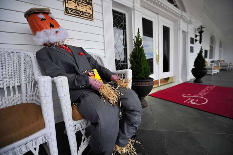 Walt Hester | Trail Gazette<br /> A white-bearded scarecrow sooms to doze with a book at the Stanley Hotel on Tuesday.