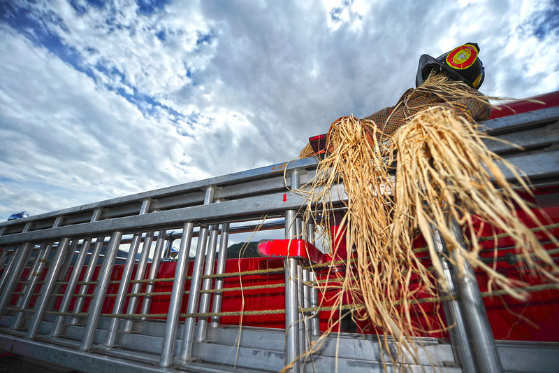 Walt Hester | Trail Gazette<br /> A scarecrow peers over the side of a fire truck in fron of the Stanley Hotel on Tuesday.