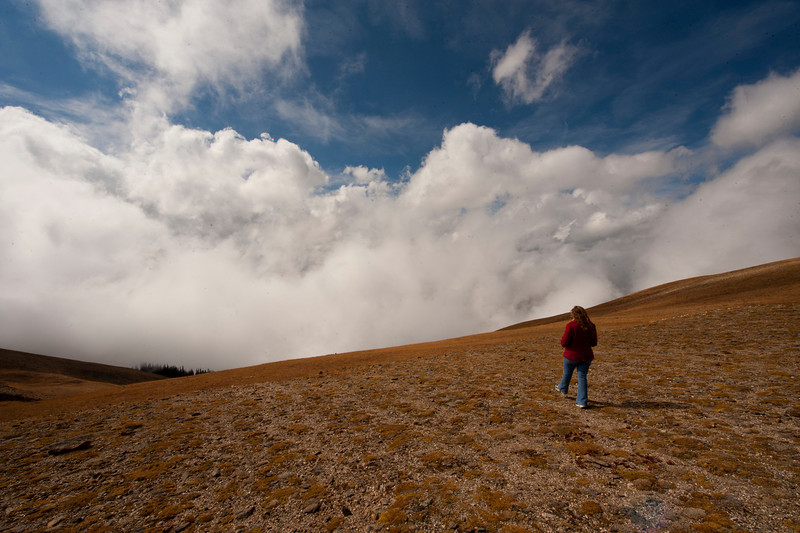 Walt Hester | Trail-Gazette<br /> Jocelyn Oguero of Chicago strolls out to the edge of Iceberg Pass, the sadle between the high points of Trail Ridge Road, on Wednesday. While much of the east side of Rocky Mountain National Park was socked in by low clouds early in the day, the clouds rose over the course of the day.