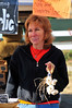 Walt Hester | Trail-Gazette<br /> Garlic lover and seller Tammi Glick displays her herb and her teeth at the Thursday farmers market. Venders were in high spirits, celebrating the last market of the season in Estes Park.