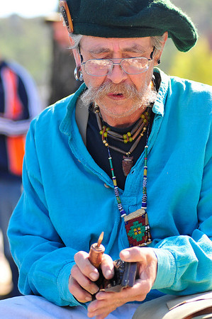 Walt Hester | Trail-Gazette<br /> Doug Dahl of Thornton, Colo. flakes away absidian to make an arrowhead at the Elk Fest in Bond Park on Saturday. Dahl was one of several mountainmen at the event showing their skills and wares.