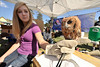 Walt Hester | Trail-Gazette<br /> Bonnie Cleaver of the Fort Collins-based Rocky Muntain Raptor Project holds a tiny Eastern Screech Owl in Bond Park on Saturday. The booth was one of many at the annual Elk Fest held over the weekend.