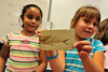 Walt Hester | Trail-Gazette<br /> Laura Ayala, 6, and Jasmine Lujon, 7, show off a fossil at the Estes Park Elementary School on Friday. First-graders were treated to a lesson about rocks.
