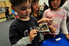 Walt Hester | Trail-Gazette<br /> Grant Gau, 6, checks out the chrystals in a geode in class on Friday. Geodes form when an air bubble is trapped inside lava and minerals grow as water seeps into the pocket.