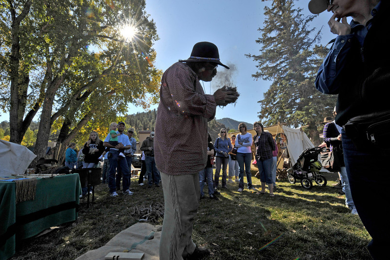 "Walt Hester | Trail-Gazette<br /> Mike ""Big Smoke"" Slayton of Loveland demonstrates how he earned his nickname at the annual Elk Fest in Bond Park on Saturday. Elk and the people who love them were out in force this weekend as warm weather and plenty of activities drew big crowds to Estes Park over the weekend."