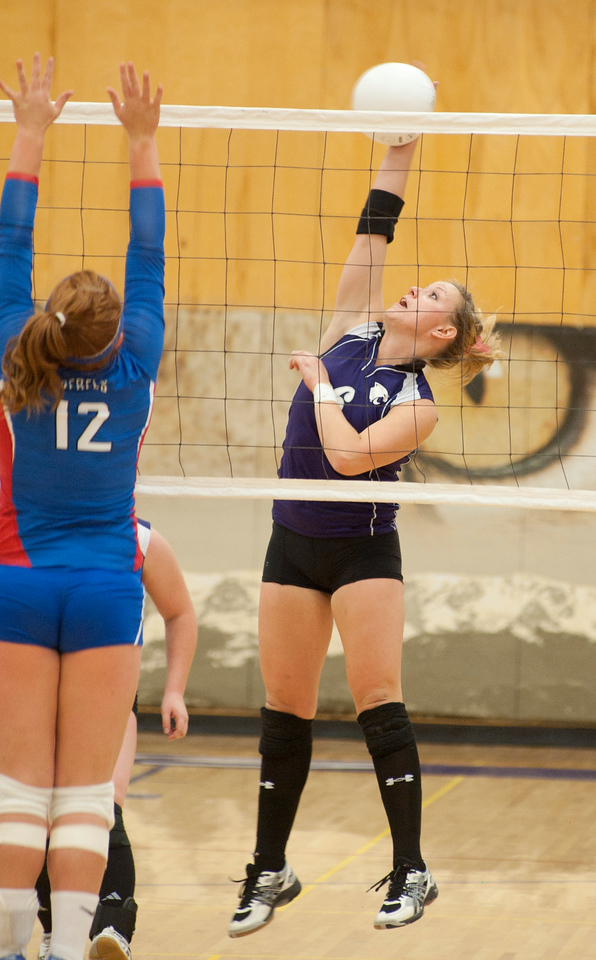 Walt Hester | Trail-Gazette<br /> Senior Kyra Stark kills a pass against Weld Central on Tuesday. While the Ladycats had some good moments, the visiting Rebels were too much for them.