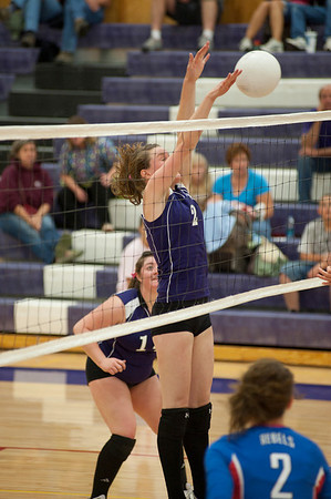 Walt Hester | Trail-Gazette<br /> Faith Weible blocks a shot by Weld Central during Tuesday's match. The Rebels beat the Ladycats 3-1.