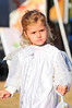 Walt Hester | Trail-Gazette<br /> Ayla Frens, 3, looks serious as she strolls through the last farmers market of the year on Thursday. The Farmers Market returns in June.