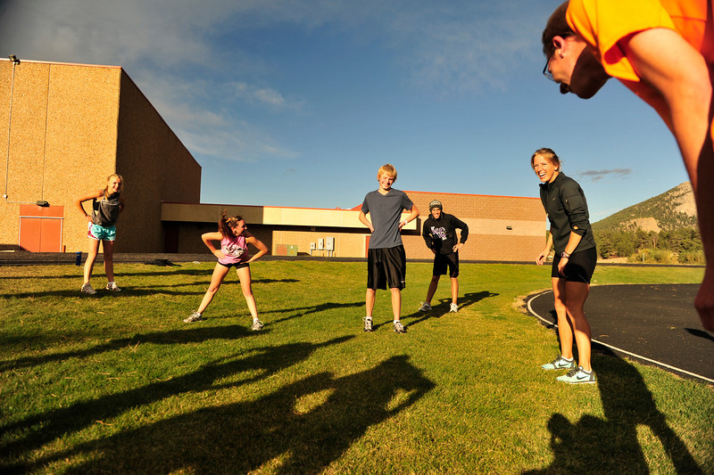 Walt Hester | Trail Gazette<br /> Members of the Estes Park High School Cross Country team loosen up, bith literally and figuritively, after their workout on Monday. The team is prepring for the regional meet slated for Lyons on Thursday, October 20.
