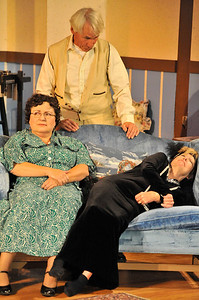 """Walt Hester   Trail Gazette Grandpa Martin Vanderhof, Played by Jim Reily, Penny Sycamore, played by Deborah Baldwin, and drunken actress Gay Wellington, portrayed by Nancy Thomas, are characters in the play """"You Can't Take it With You."""" The Fine Arts Guild og the Rockies are in rehersal and will present the three-act comedy at the Hemple Auditorium at the YMCA of the Rockies beginning Friday, October 14."""