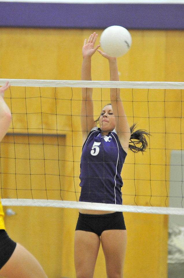 Walt Hester | Trail Gazette<br /> Erin Barker stretch for a block against the Brush Beetdiggers on Thursday. Barker and teammate Faith Weible have put up good blocks in the last two games.