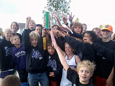 Courtesy Ruby Bode The Estes Park Middle School Boys Cross Country team celebrates their third consecutive Norther Plains League Championship on Tuesday. The girls placed third in the league meet, with a first and second place from Lily Tomasula Martin and Emma Laurienti, respectively.