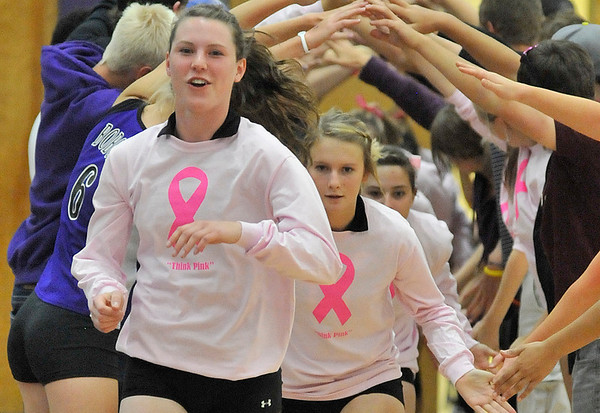 "Walt Hester | Trail Gazette<br /> Faith Weibel, Jesse O'Dell and the rest of the Ladycats wear ""Think Pink"" shirts at the start of Tuesday's home volleyball match. The shirts were worn in honor of Breast Cancer Awareness Month."