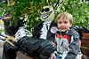 Walt Hester | Trail Gazette<br /> Jesse DuPuis, 5, of Cambridge, NY, sits next to a scarecrow along Elkhorn Avenue on Monday. The scarecrow is part of the month-long festival of scarecrows in Estes Park.