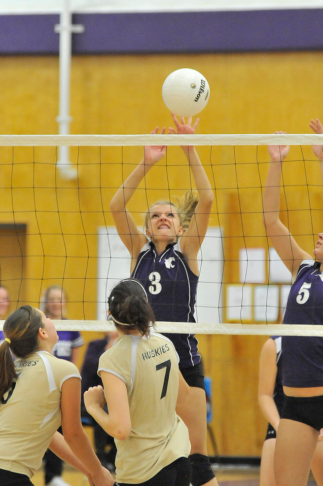 Walt Hester | Trail Gazette<br /> Karin Kingswood leaps for a block against Highland on Tuesday. Kingswood was singled out for praise by her captain in her efforts to help beat the Huskies.