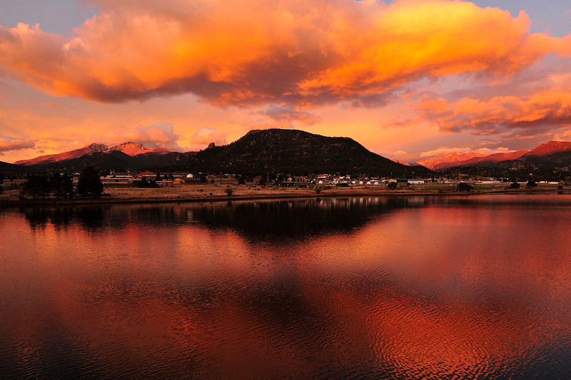 Walt Hester | Trail Gazette<br /> Sunrise paints clouds and mountains over Estes Park on Thursday. Fall weather rolled in over the weekend dumping snow on Estes Park and the high peaks, though warmer weather quickly returned.