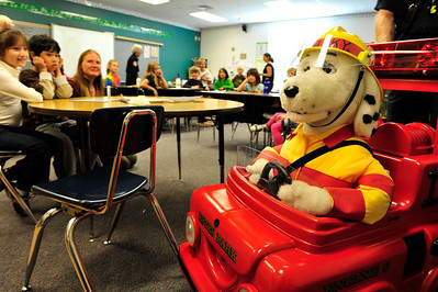 Walt Hester   Trail Gazette Spark the Fire Dog tells third-graders about fire safety at the Estes Park Elementary School on Wednesday. The animated electronic dog spent the day at the school.